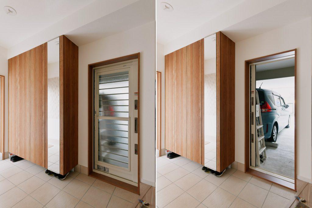 1F玄関:大収納のフロート収納とガレージに続く扉